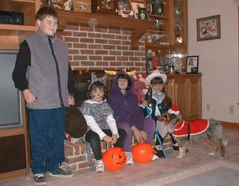 Halloween 2000. Steph the cowgirl and Mason the SantaPaws
